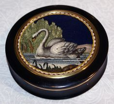 A tortoiseshell snuff box with a micromosaic of a swan