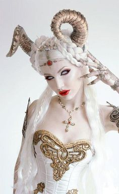 Beautiful goddess with horns SFX makeup idea / Pairs nicely with frosty FX contact lenses => http://www.pinterest.com/pin/350717889705763104/