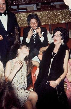 Jane Birkin, Serge Gainsbourg and Jane's mother at a party in Paris, 1970s,
