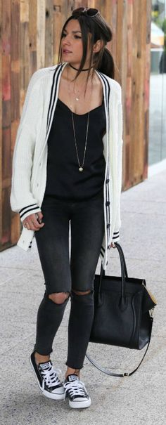 cable knit cardigan + pair of ripped black jeans + Federica L.'s + cute and casual style + affordable and achievable  Cardigan: Asos, Top: Zara, Jeans: Bershka, Shoes: Converse.