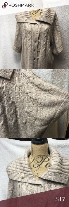 Sweater Shawl Beige/tan colored sweater shawl is a fall must she. Wear collar open or fully button for more neck coverage. Great for fall day with boots and jeans or even a nice pair of pants would work well too. Sweaters