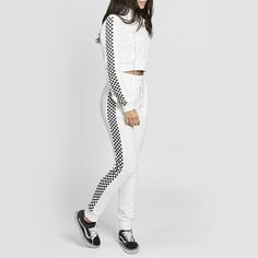 GODSPEED TRACKSUIT * Checkered Tracksuit * Sold as a set * White tracksuit, checkered detail. * Frontal zipper closure * Runs true to size * Model is wearing a size Small