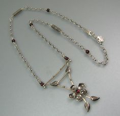 Flower trellis necklace with garnets in sterling silver