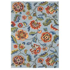 Add a pop of pattern to your living room or den with this hand-hooked rug, showcasing a floral motif in blue.    Product: Rug