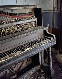 Abandoned piano in a building in Detroit this would be amazing