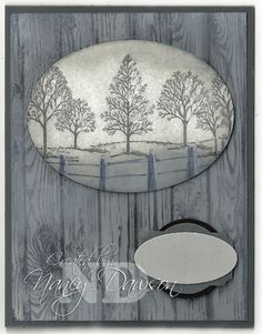 handmade card from Paper Dreams & Creative Wishes ... shades of gray ... hardwood wood grain boards stamped background ... oval with Lovely as a Tree stamp with fog technique ... layered sentiment tag black for now ... luv the creative use of this stamp! ... Stampin'Up!