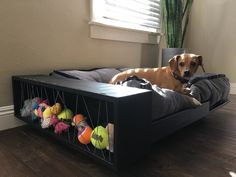 This is an amazing sleek and modern pet bed. Looks like it's floating, but don't fret, this bed is sturdy and built for large or small pets and can sleep multiple pets. The extra comfie cushion, upholstered with a beautiful washable fabric, will have you literally dragging your pet away from it to handle their outdoor business. Believe us we tried, not even treats could get our mutts out the bed. This bed also has a storage shelf for you to hide away your pets favorite toys ...