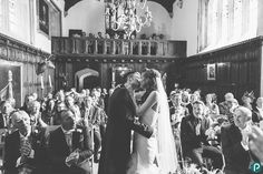 Bride and groom first kiss at Athelhampton House wedding in Dorset