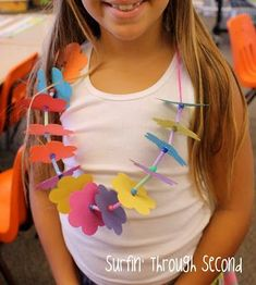 May Day Is Lei Day in Hawaii Make a paper lei out of paper flowers, beads, yarn and straws