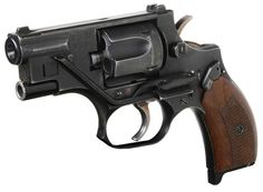 Russian OTs-38 Special Silent Revolver. This uses ammunition with a captive piston to fire projectiles. It fires from the bottom cylinder and what looks like the barrel along the top of the frame is actually an integrated laser.