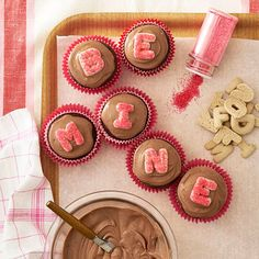 CUte idea... spell out messages with sugar cookies on cupcakes! #valentines #treats