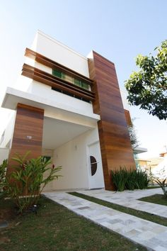 Cool modern house incorporating wood in the exterior.
