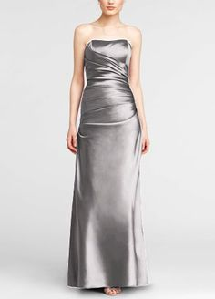This elegant satin ball gown is simple yet stunning, and the classic silhouette will flatter any figure.  Ruched bodice creates feminine curves.  Simplicity of the strapless neckline offers a beautiful contrast to the drama of the gown.  Rich satin fabric radiates a gorgeous sheen.  A- Line Silhouette.  Fully lined. Back zip. Imported polyester. Dry clean only.  Get inspired by our colors.