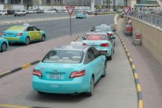 Taxis in Doha!!! cool colour!!! :p
