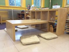 Expedit Preschool Children's Table + Shelving - IKEA Hackers. simply cut desk down to size for kids. great idea!