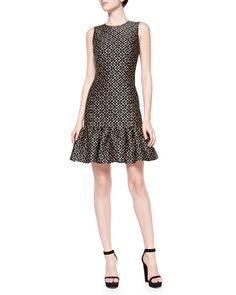 Michael Kors. Very pretty. No reason to pay that much for 1 dress though.