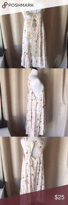 Free People BoHo chic dress Free People Bo Ho chic flowey dress is gorgeous. It has a bit of a high low to it. It loose so it can be worn with a cami or a cute bralette. With some strappy brown sandals or booties, this dress can be worn anywhere. Free People Dresses High Low