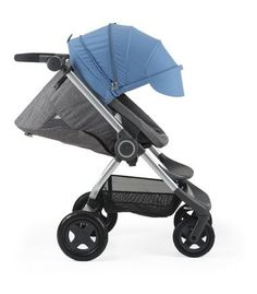 Stokke® Scoot™ Black Melange with Blue Canopy. Forward facing, sleep position with ventilation open.