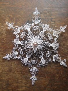 One set of large quilled snowflakes