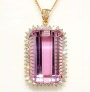 Ritika Kunzite: The Ritika Kunzite is a flawless 75.54 carat natural pink Kunzite surrounded by 1.65 carats of blazing Diamonds hand set in 18K gold. This is a rare and massive stone. The Ritika was named after the wife of the lowly gem trader who uncovered the famed gem and faithfully returned it