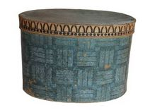 "This early 19th C. wallpaper covered hat box is in very good condition.  It is covered in a wonderful hand stenciled blue-weave design wallpaper.  This box is one of two being offered, both of which were passed down through the same Pennsylvania family.  Although this one is not lined in early news print like the other one it does contain a lady's hat, two scarfs, and a hand written note describing past ownership. This one is the smaller of the two, measuring 16"" wide by 11-1/2"" deep by 11""…"