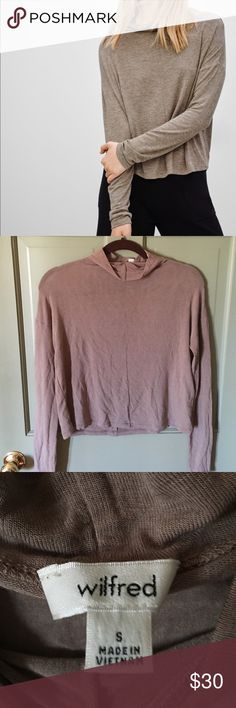 NWOT Wilfred sheer mockneck tee Never worn mockneck tee from Wilfred by Aritzia. Slightly sheer, shown on model in different color for fit reference. Size small, mauve/taupe color. Slightly cropped length, perfect for high waisted bottoms! Aritzia Tops Tees - Long Sleeve