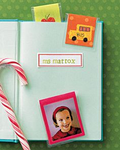 Dress up a blank journal with a magnetic bookmark. Decorate the bottom half of a rectangular piece of paper. Cover with self-adhesive laminating sheets. Bend in half, and attach seld-adhesive magnet strips to inside of ends.