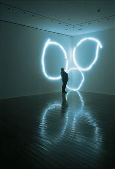Claude Lévêque Double manège  2002 Three circular lines of white neon lights 400 x 550 cm