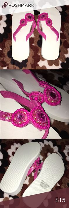 Pink and White Wedge Flip Flops *NWOT* These are some white and pink wedge flip flops from Avon. NWOT. It is a size 7.5. If you have any questions please feel free to comment below. Also bundles of 2+ get 15% off. Avon Shoes Sandals