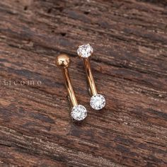 Any quantity of the goods is only one shipping charge. <<<  This listing is for 1 piece  Will be safe packed in a craft gift box.  The bar is a standard 16 gauge.  Internally threaded, only on side can detachable. Material: hypoallergenic surgical steel. Zircon Diameter: 3mm. Bar length(without zircons): 8mm.  Shipping Return Refund: Please visit my store policy: https://www.etsy.com/shop/ticomo/policy  Thank you for stopping by! Please take a look around th...