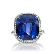 "Harry Winston's ""The One"" with a cushion-cut sapphire center stone and pave diamonds, set in platinum"