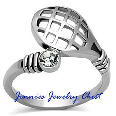 The perfect ring for the tennis lover in your life. A unique blend of a racquet design, with a sparkly crystal to represent the ball. All set in a stainless steel band. If you have never experienced s                                                                                                                                                     More