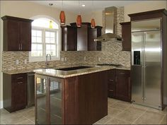 Santa Cecilia Granite Dark Cabinets Backsplash Ideas. Information for kitchen remodeling, cabinets, backsplash types, painting, flooring, and pendant lights