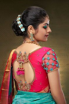 In a bridal look in a green color pattu / kanjeevaram saree, pink color elbow length sleeve blouse design, necklace, hip chain, maang tikka / head piece and jewelry Source by designs Cutwork Blouse Designs, Wedding Saree Blouse Designs, Simple Blouse Designs, Stylish Blouse Design, Latest Saree Blouse Designs, Pink Blouse Design, Pattu Saree Blouse Designs, Blouse Styles, Sari Bluse