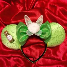 All you need is faith, trust, and (these super sparkly Tinker Bell ears with) pixie dust. **ABOUT OUR HEADBANDS** Each item is handmade; subtle, minor differences are to be expected. **CARING FOR YOUR NEW EARS** Much like ears sold in the parks, our headbands should be handled with care. Do not let them get wet, do not expose them to bright light, and never feed them after midnight ... Wait ... Thats Gremlins. Well, like Mogwai, our headbands really shouldnt get wet. So always remove your…
