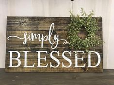 Simply Blessed sign reminds us how blessed we are each and every day. Dimensions are approximately 14x24 This sign is stained with white letters. It has a green baby grass wreath on it. All of my signs are handmade by me. Due to the nature of distressing wood and rustic look no two