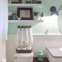 Aqua and bronze bathroom