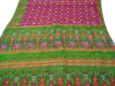 * PRODUCT DESCRIPTION * Vintage sari in pure silk fabric. * Main color includes magenta and green with bits of yellow, orange and blue color.