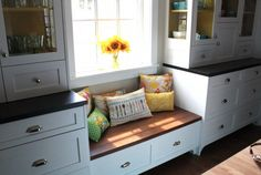Love a little bench in the kitchen for the kids to hang out on...click to see loads of more cute pics