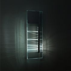 FUTURA wall The Futura object made of colourless glass. By the subtel hand made lighting pattern appear from the interior. It gives a unique mood in a modern appointed living-room. Light of the future.  #futura #emandes #emotivelamp #walllamp #lightingdesign #handmade #craft #opticalglass