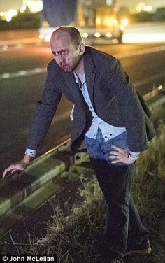 Dazed and bloodied: Ben Ellery staggers to the side of the road after .the crash..reporters MoS man chillingly tells how he narrowly avoided death when a tree trunk was hurled at his car by migrant gangs in Calais    Daily Mail Online16