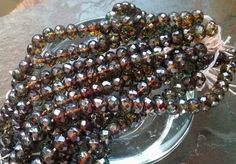 Faceted Puffy Rondelles, 6x4mm, Czech Firepolish, Rhondelles, Transparent Olive Brown Luster, 25 Beads per Strand, Priced per Strand by DragonflyBeadsStudio on Etsy