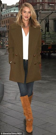 Always stylish: Rosie rocked off-duty model chic in her stylish ensemble as she braved the London weather