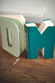 book letters/ Would be so cute for centerpieces! Especially if you could find older, already ruined versions of your favorites. (I couldn't ruin a perfectly good book!) // by GritandGoldfw.com