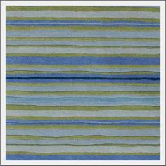Coastal Living Sawgrass Rug. Hand-tufted wool rug in hues of blue and green strike the perfect balance between coastal style and comfort. From the official Coastal Living Collection.