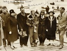Amelia Earhart (1897 - disappeared 2 July 1937) Signed Photo, Taken Immediately After Her Successful Flight as the First Woman to Fly Across the Atlantic, Also Signed by Flight Team Stultz & Gordon