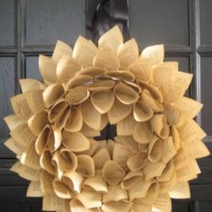 Step by step photo tutorial to make this stunning wreath out of a dilapidated book.