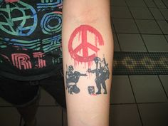 Banksy Peace Sign Soldier tattoo littlestatebigink.blogspot.com