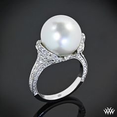 Kinda the right idea, maybe less shiny, get a natural pearl not fully rounded, less diamonds