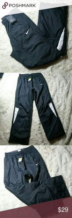 "Nike Women's Challenger Track Pants NWT Small New with tags, the nike women's challenger pant is a warm up pant with storm-fit for waterproof protection. Bottom side zippers at the hems, pockets at the hips that zip shut. Elastic waistband. Size small. Retail: $65.00  Waist 14"" Rise 11"" Inseam 30.5"" Leg Opening 9.5"" Nike Pants Track Pants & Joggers"